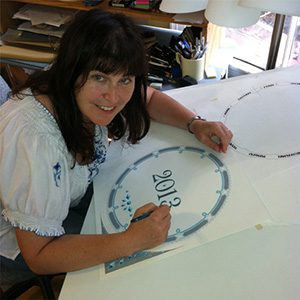 Mickie Caspi creating the Jewish Art Calendar in her studio in Newton, Massachusetts